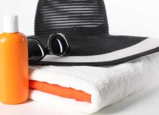hat, towel, sun cream, sunglasses